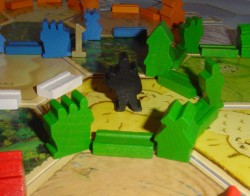 Catan: een rover omringd door ridders